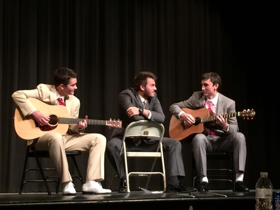 Seniors Mike Riley, Brennan Cornwall and Keagan Rallis perform