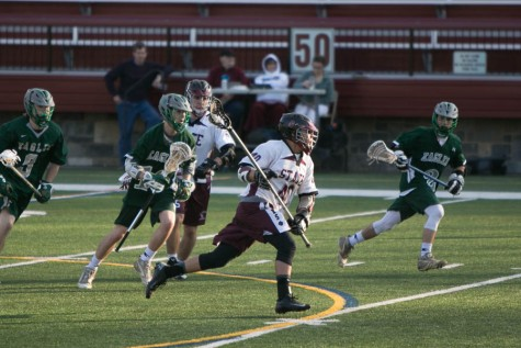 Felix Sanchez passes the ball at Memorial Field against the Bishop Shanahan Eagles.