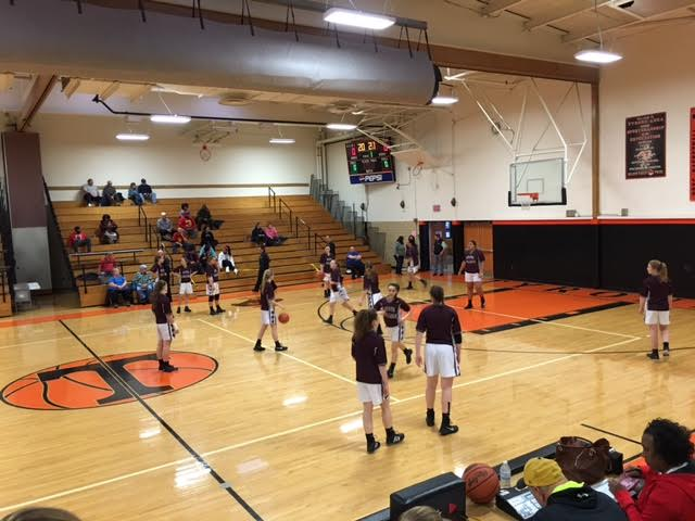 Girls Basketball Team on March 4th, 2016 warming up for States.