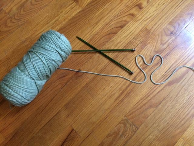 Yarn and knitting needles are used to knit.