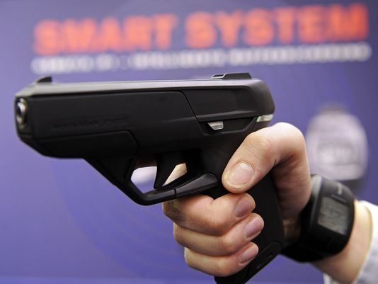 A smart gun is displayed at a conference in 2010 (Photo: Joerg Koch, AFP/Getty Images)