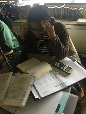 Kyra Gines, freshman, imitates the life of a State High student during AP and finals week.