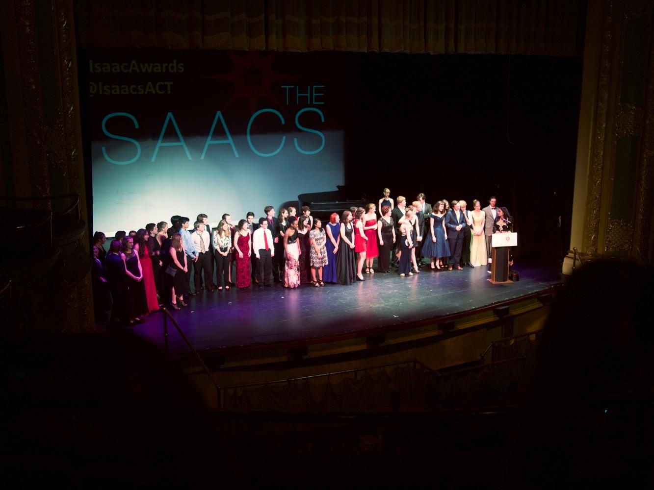 Senior Tima Ally speaks as the rest of the State High Thespians stand on stage after winning runner up Best Production at the 12th Annual Isaac Awards.
