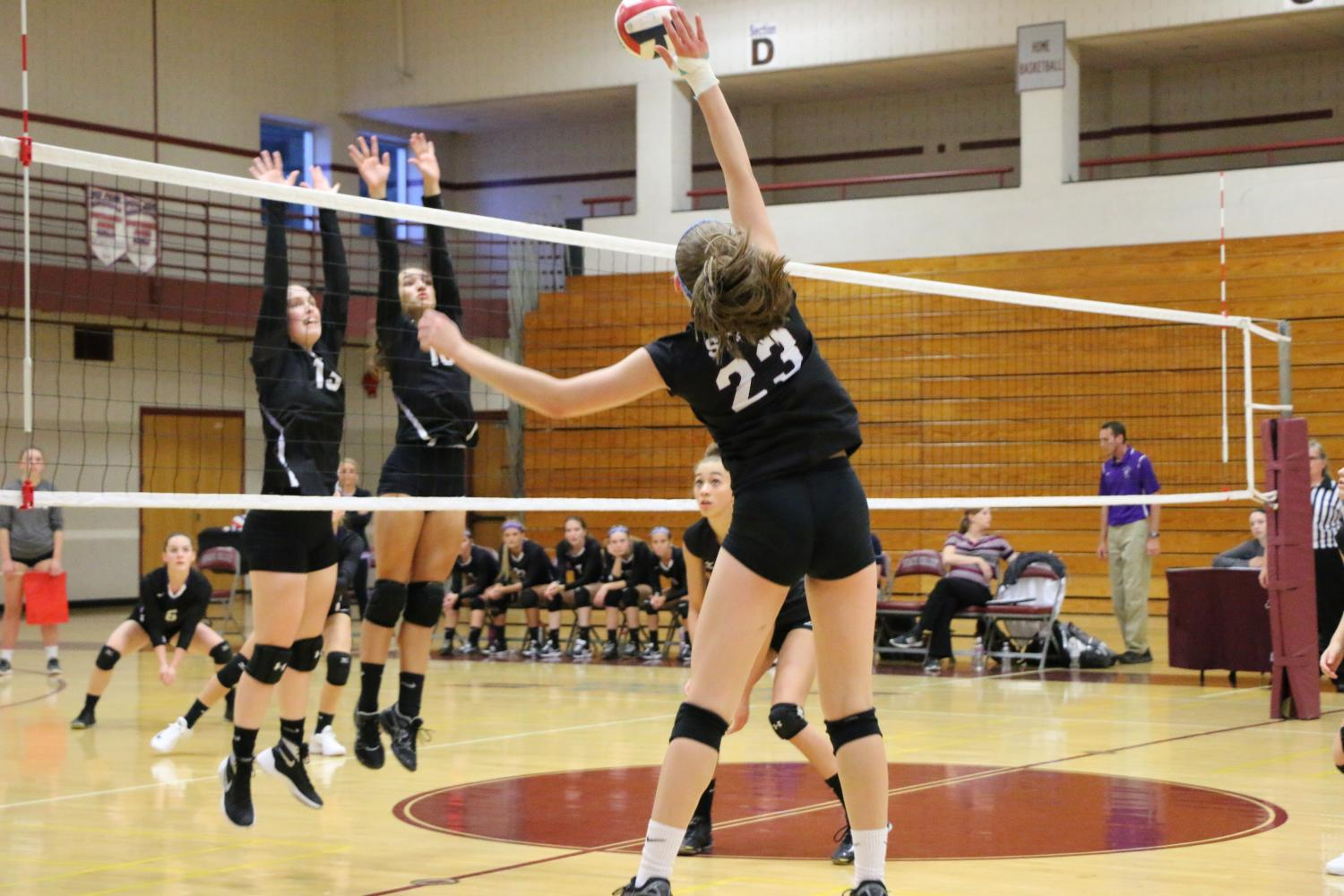 Kate Lachendro, a sophomore, hits the ball towards Mifflin County.