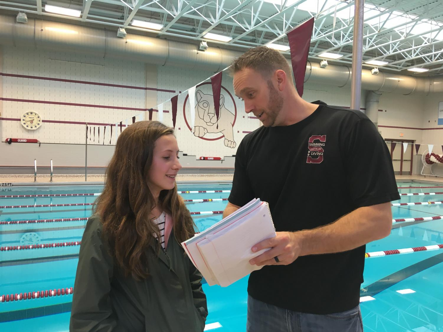 """After the pre-season meeting for swimming and diving, sophomore Aubrey Zuech and head coach Aaron Workman meet to discuss goals for the new season. With a strong team for both girls and boys and a new head coach, the team hoped for an even more successful season than last year. """"I think it's going to be a good season. Different coaches bring out different things in swimmers, so I think there's a chance we could be more successful [than last year],"""" Zuech said."""