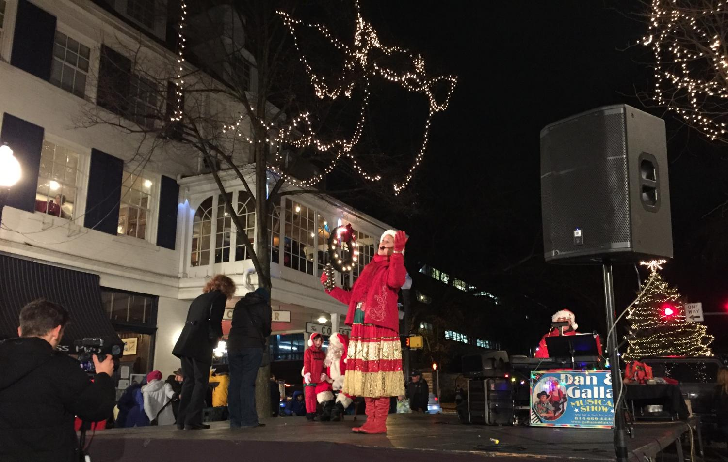 Galla of the Dan and Galla Musical show performs on the stage during the annual Christmas tree lighting.