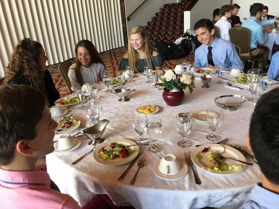 "Exploring business students enjoying their meal at Mountain View Country Club. Freshman Leslie Powers said, "" It was a valuable, and fun experience to go through with my friends. I had a good time learning about how you dress for these events and learning what is, and isn't acceptable."" The students practiced professional dinner etiquette on the field trip so that they are prepared for future dinner meetings."