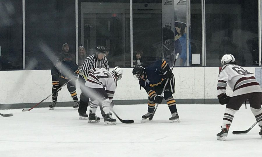 "At the start of the hockey game on Thursday evening, two center players from each team engage in a face off. Braden Wandrisco, junior,  played center for State High. ""My position requires a mix of offensive and defensive plays. The center position leads the offensive rushes and is an all-around player in the defensive zone,"" Wandrisco said."