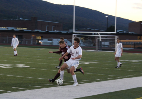 """Jacob Whipple, a senior(46), defends against Altoona on Halloween night. Whipple felt the team did a good job of """"taking chances while still maintaining possession."""" Sadly, State College returned from Bald Eagle with a loss of 0-1."""
