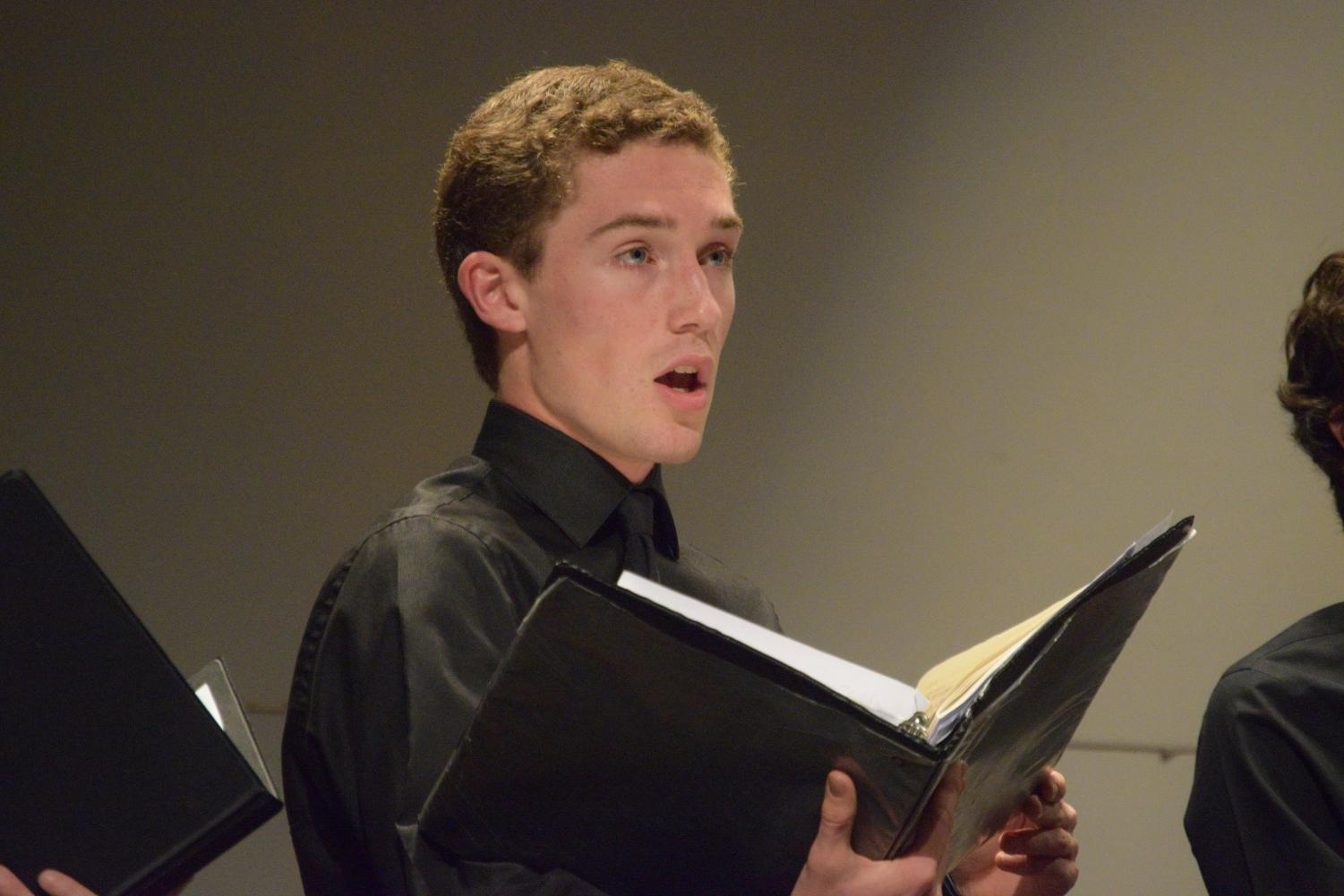 "Junior Jackson Dillard, the vice president of State High Choirs and a member of Master Singers, Chamber Singers, and Only Men Allowed, performs ""Sound an Alarm"" by Friedrich Handel at the Autumn Song concert. When asked why he likes to sing, Dillard responded,"