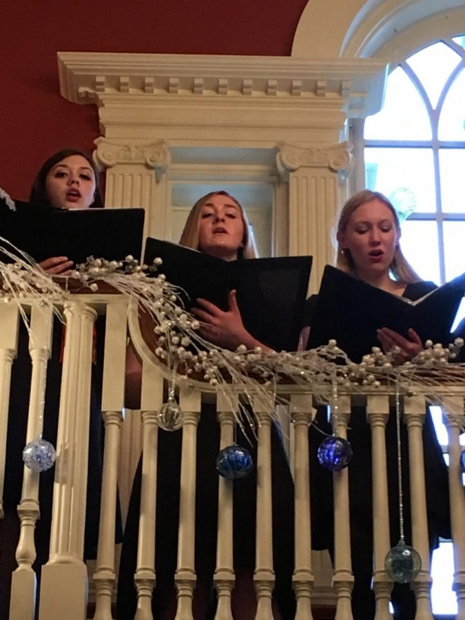 """Members of the a cappella ensemble Chamber Singers, including junior Tori Robinson and seniors Emily Lieb and Eva Hirsch, perform a selection of holiday songs at the Governor's Residence. Chamber Singers and Treble Makers, its underclassmen counterpart, traveled to Harrisburg on Sunday, December 10th to perform for visitors of the mansion as a part of the holiday celebrations. """"I've never been to the Governor's Mansion, nor did I ever think I'd go [there]. With any choir event, it always takes you to different places you never think you'll go and it pushes you to perform in different kinds of venues,"""" Robinson said."""