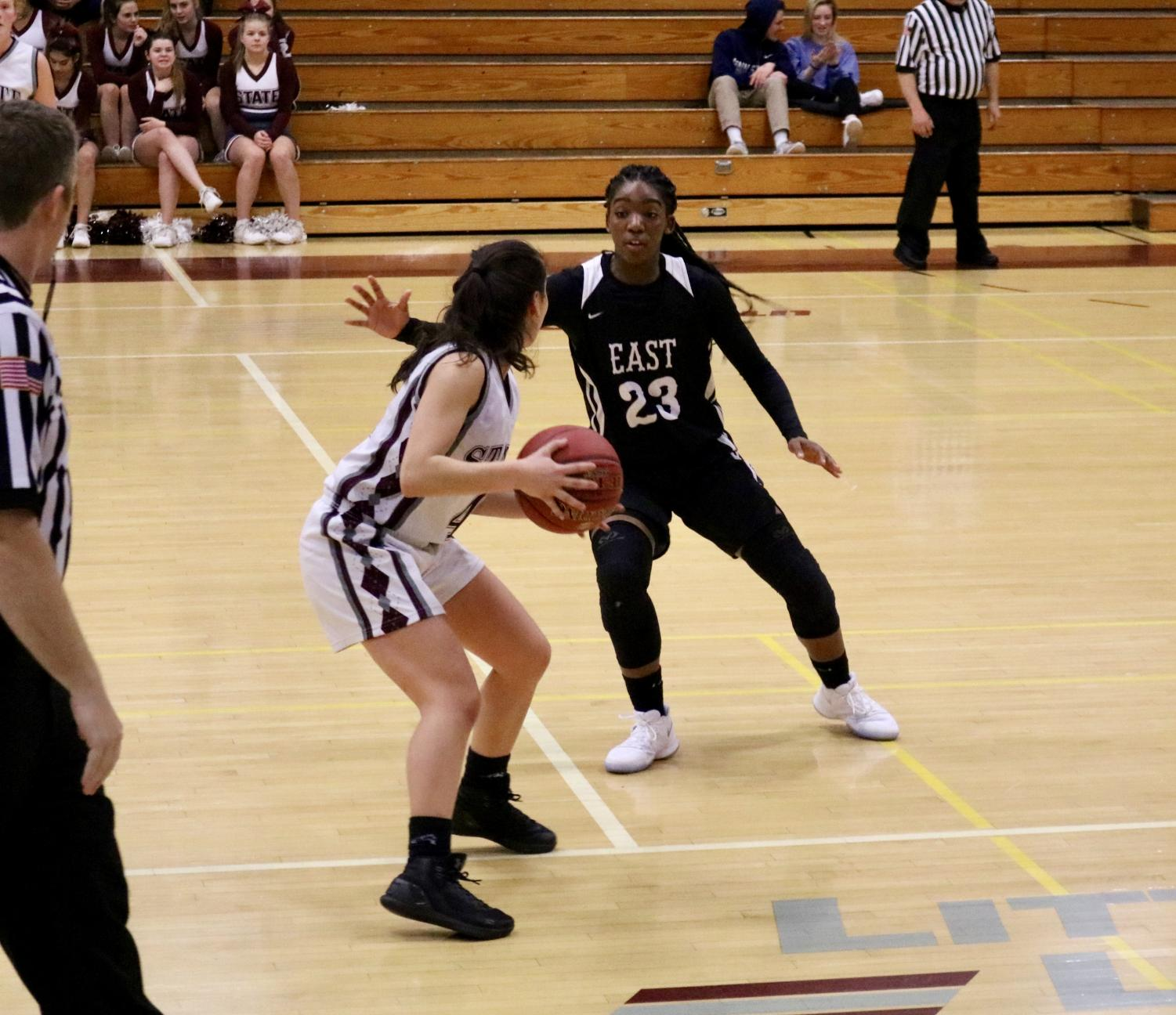 Junior Lexi Risha shields the ball from a Central Dauphin East defender during their December 12th victory.