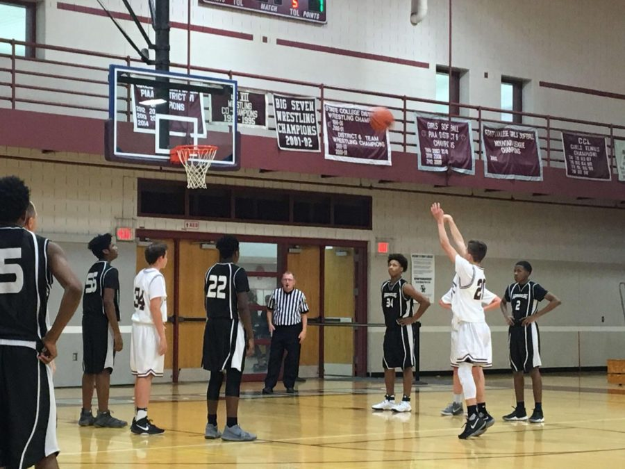 The boy's freshman maroon  basketball team playing during their game on Friday, December 15 against Harrisburg. Trey Oyler shooting a foul shot during the 2nd quarter. He said,