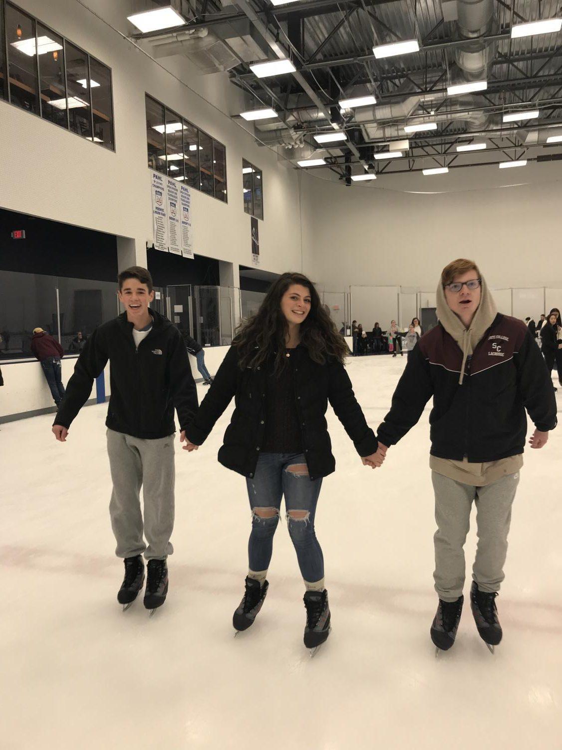 "Jack Shallenberger, Abby Kissell and Neil Porterfield, seniors, ice skating at Pegula Ice Arena during public skating on Saturday, December 16th. ""Ice skating really brings out my inner athleticism and is a great way to connect with my friends. I went skating because it is a festive and exciting activity,"" said Porterfield."