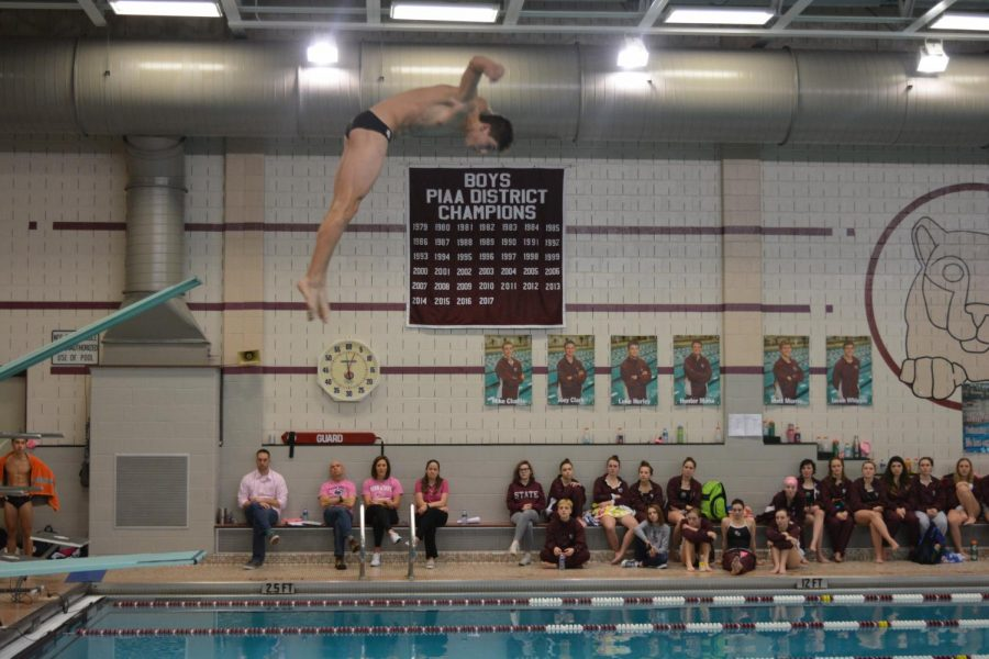 "Jacob Whipple,  senior, diving at the first home meet of 2018. ""My favorite thing about diving is that even when I'm having a bad day on the boards, I still have a good time being with my teammates."" Whipple said, ""I get frustrated very easily, but when things don't go my way, I can always find a way to have a good time,"" he added. The meet took place at home in the North Gym against Cumberland Valley."