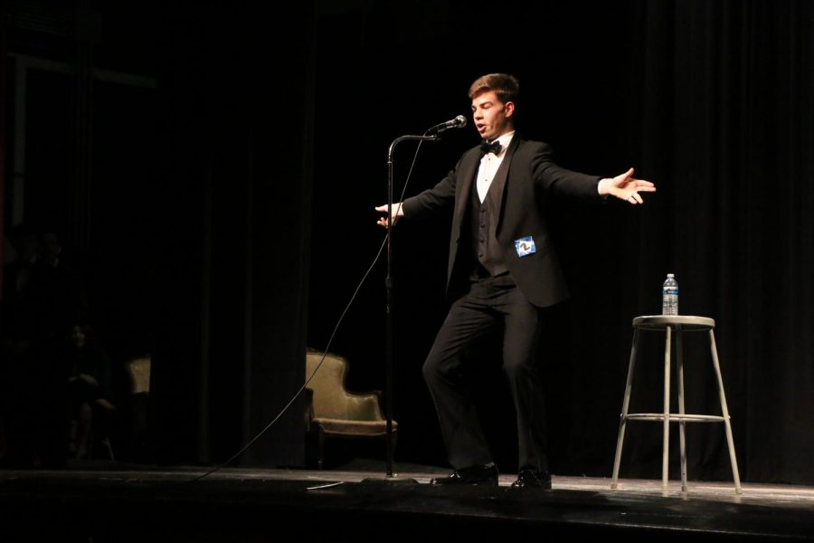 Nick Vanden, senior, performs his stand up comedy routine.