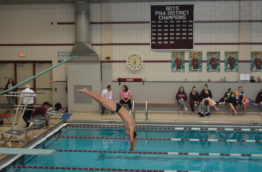 "Jacob Whipple, senior, dives at the first home meet of 2018. ""My favorite thing about diving is that even when I'm having a bad day on the boards, I still have a good time being with my teammates."" Whipple said, ""I get frustrated very easily, but when things don't go my way, I can always find a way to have a good time,"" he added. The meet took place at home in the North Natatorium against Cumberland Valley."