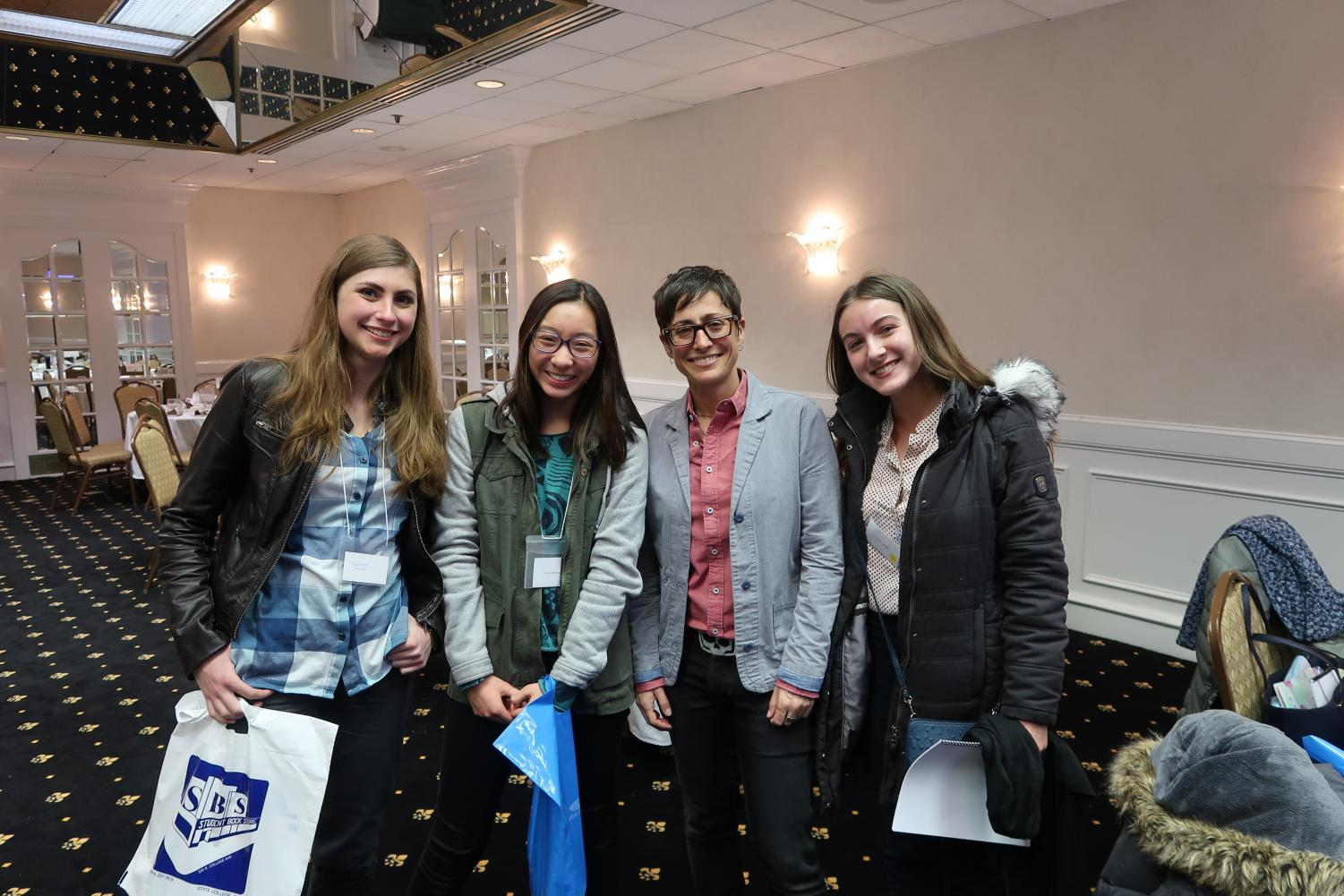 "State High seniors Hannah Strouse, Hana Wiessmann and Grace Handler excitedly met and talked to Danielle Feinberg during a break period at the Women in Science conference. The students expressed their love for Pixar, Danielle Feinberg's work and the power of films. ""I learned the most from Danielle's talk, I didn't know how much work was put into such little details in each of Pixar's films,"" Strouse said."
