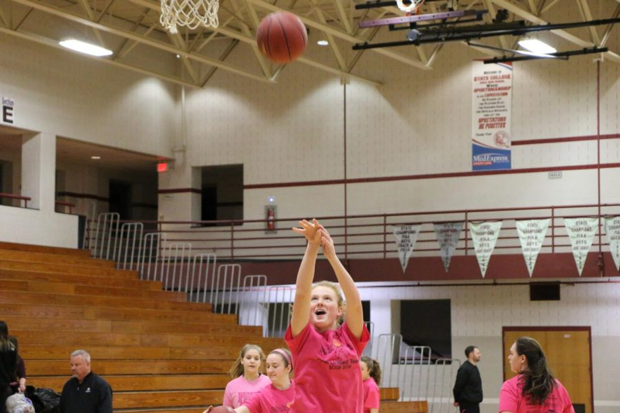Kelsey Love, junior, shoots during the team warm-ups.