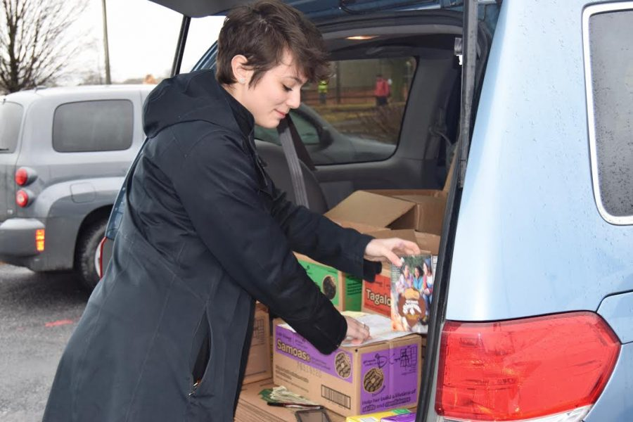 Senior Delaney Kenyon gathers boxes of Girl Scout cookies to sell. Girl Scout cookies are now available to be purchased in State College. For many Girl Scouts, selling cookies is an enjoyable and rewarding experience.