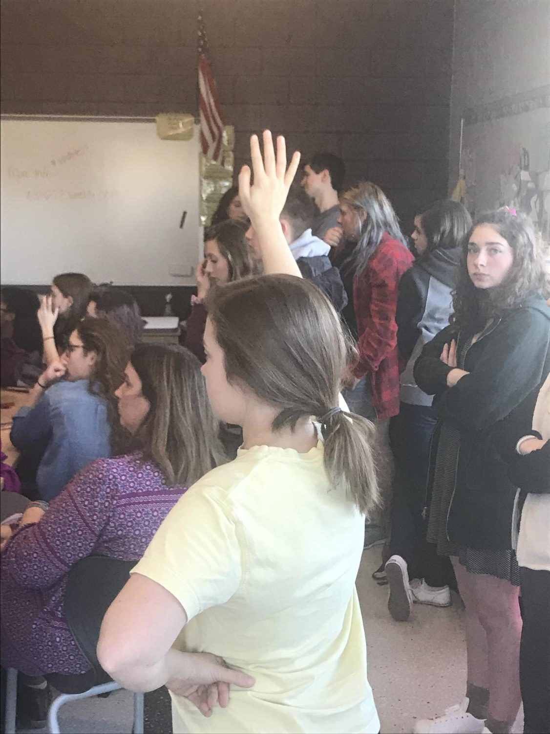 Students raise their hands to discuss the gathering being planned for March 14th. Photo by Joie Knouse