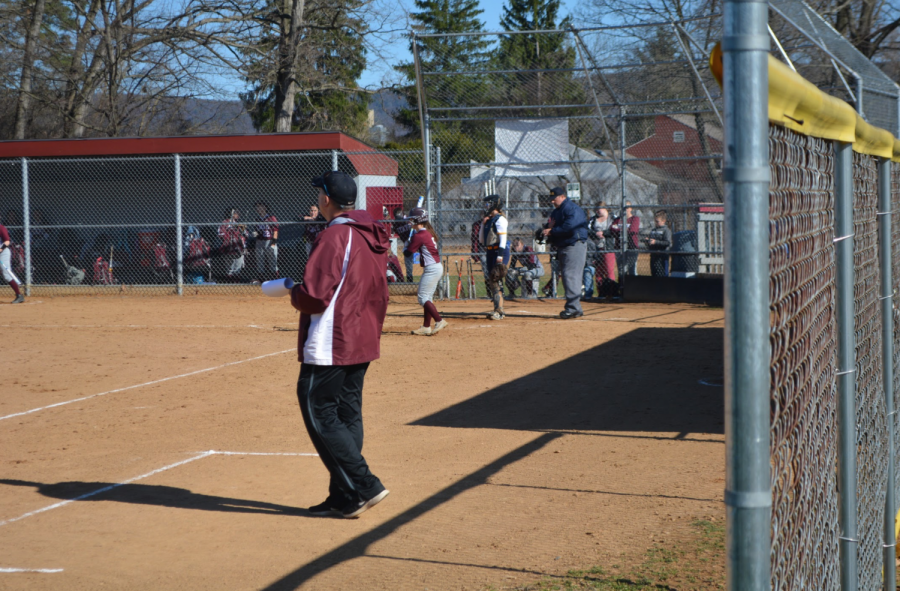 Head Coach Jim Schaper coaches the girls softball team on April 20th.  With weeks left in the season, he knows the importance of zoning in and putting together a championship team.
