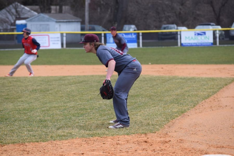 "Tyson Cooper (16), junior, stands at a base and surveys the field during the game against Central Dauphin High School. Varsity Baseball won the game with a 13-3 score, demonstrating their hard work during the season so far. ""We started off a bit slow this season, but the win against Central Dauphin gave us some momentum,"" Cooper said, adding, ""All we have to do is stay focused and keep competing and we'll get it going."""