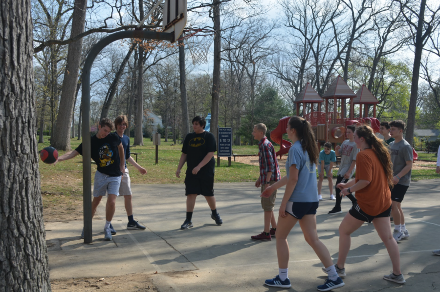 "Little Lion Ambassadors engage in a game of basketball. ""Outdoor, physical activities are almost always fun for me, especially when it is organized and there are a good amount of participants,"" freshman Brady Bigger said. Many LLA's made sure to pack their days filled with plenty of fun and games."