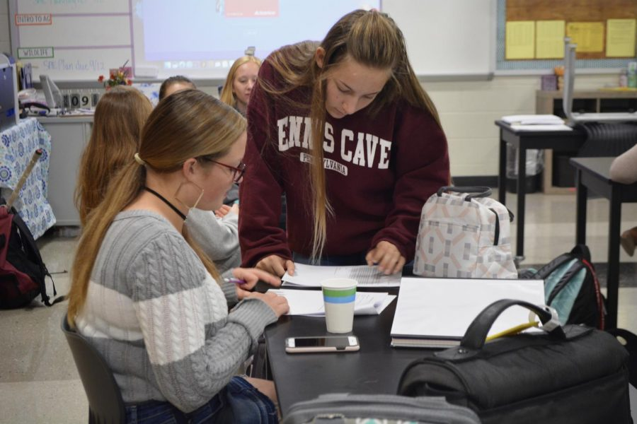 Cameryn Rousselin (maroon) assists Kiera Perkins, to fill out her State College Little Lions FFA chapter officer application at the first chapter meeting of the school year. Perkins is applying for the officer role of Treasurer.
