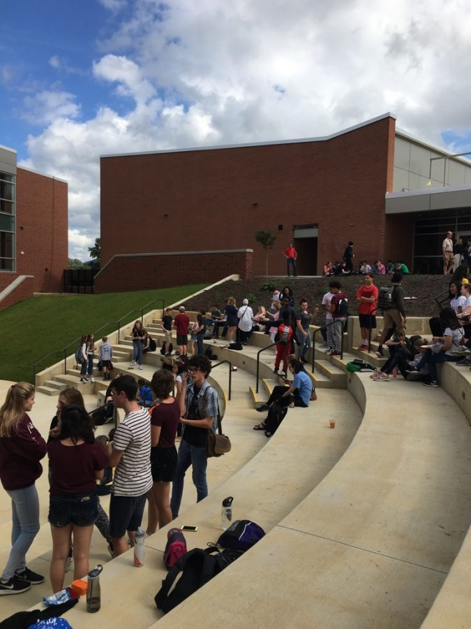Students are enjoying their lunch at State High's Outside Sitting Area