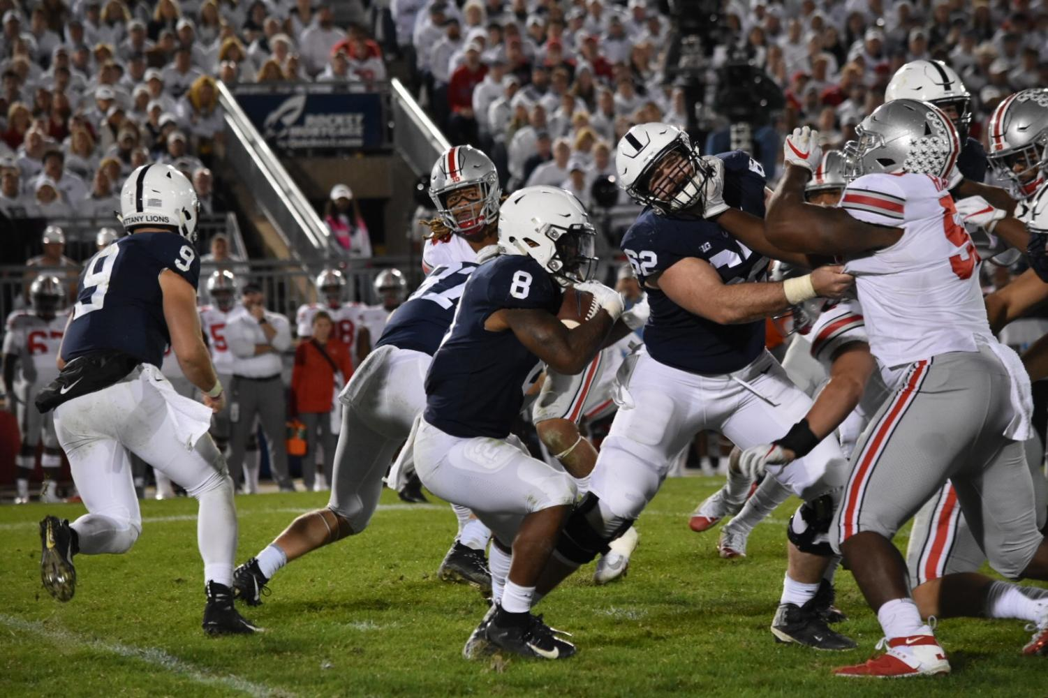 Quarterback, Trace Mcsorley, and Running Back, Mark Allen run while making a play in the Ohio State game. The game was Penn State versus Ohio State at Beaver Stadium. The final score was 27-26. Penn State lost by one point in the last seven minutes of the game.