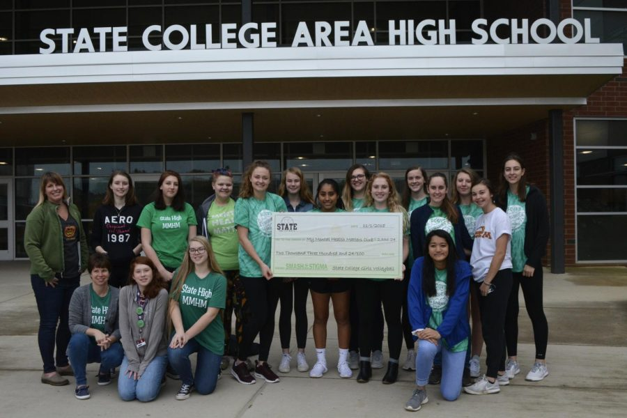 The Volleyball team and MMHM club stand together to present their check  for the money raised during the Green Out game.   First row from left to right: Suzanne Lyke, Hailey Steele, Gwyneth Jones and Emi Shukla.  Second row left to right: Jess Irwin, Anjelica Rubin, Leah Henderson, Katie Finlin, and Maria Chapman.  Third row from left to right: Jennifer Evans, Sarah Hart, Isadora Drager, Jessica Griel, Anna Witmer, Mariah Airey, Abby Fozard, Samantha Shala, and Claire Jordan.