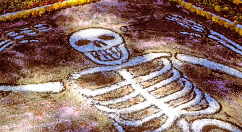 Dia de los Muertos, a holiday that has taken in Mexico and other Latin America for centuries. The celebration takes place to honor and celebrate the dead, and in order to do that many festivities take place. The purpose of the holiday is not to mourn the dead, but to honor them and celebrate with them. Photo courtesy of:  Jack Parsons / Omni-Photo Communications, Inc. / Universal Images Group