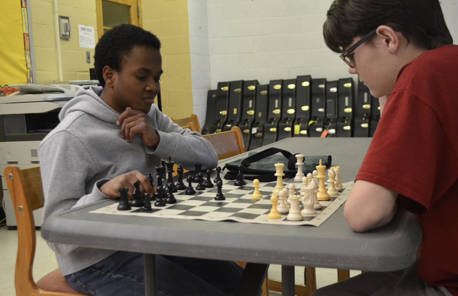 "Freshmen Ryan Mckee(left) and Jason Sims(right) playing a game of chess. Chess Club makes the experience of playing chess even more interesting. ""Chess is a really fun game, that builds up your critical thinking,"" Ryan Mckee said."