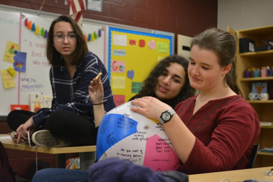 Members of State High's Diversity and Activism club read questions written on a beach ball during a group activity. On Tuesday, December 11th, club members came together to celebrate diverse cultural holidays.