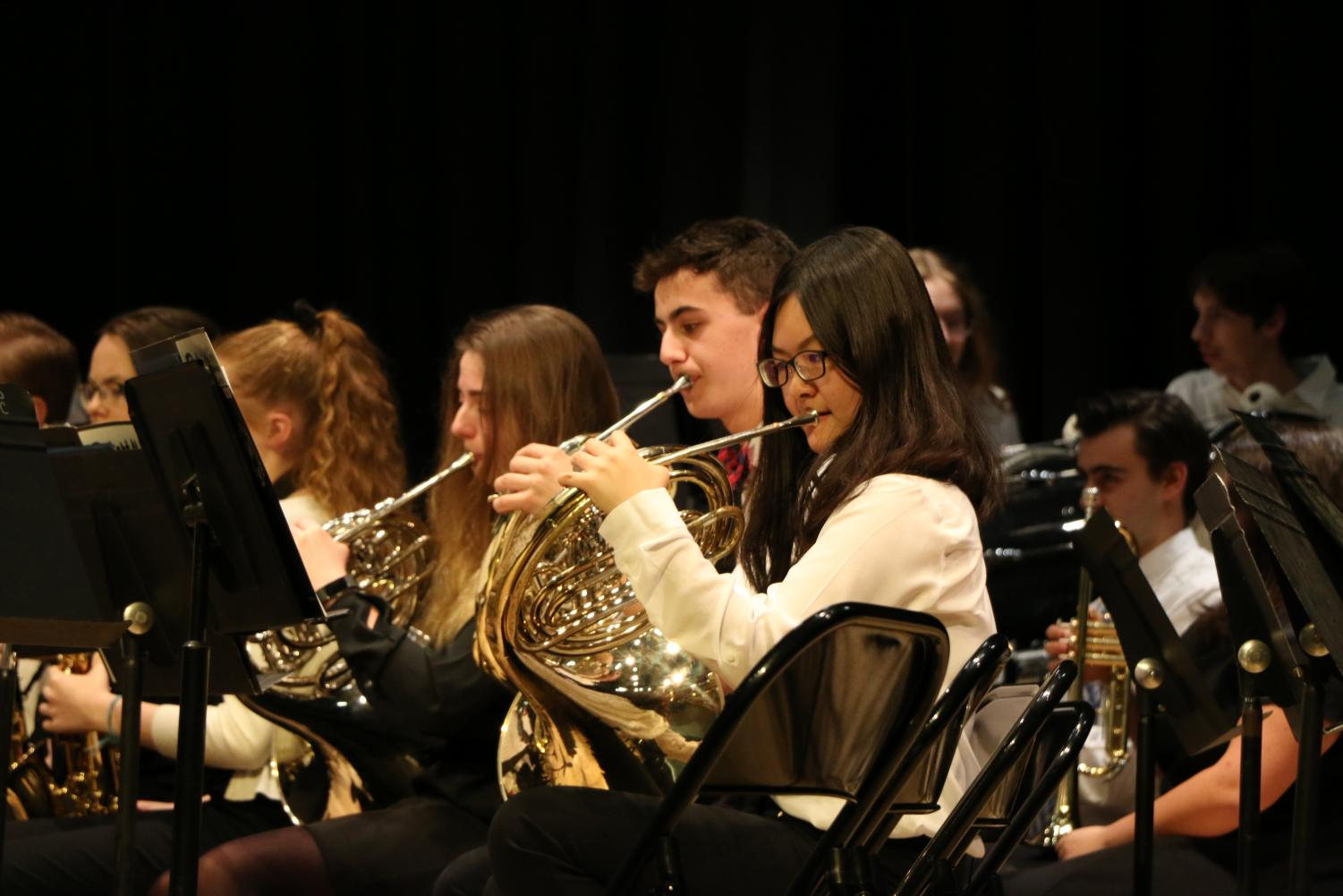 Heejung Koo, sophomore French horn player, plays her French horn during the Concert band concert. Koo said her favorite part about being in the Concert band is,