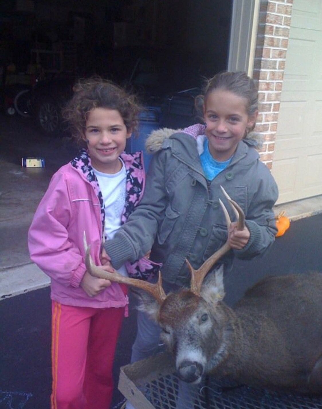 Sophomore Jacquie Gordon (left) and junior Jess Gordon (right) pose with a buck in 2009. The Gordon's have been involved in the culture of hunting for the majority of their lives.
