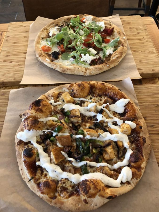 The MexiQue and the Farmers Market pizzas on display at Snap Pizza. Snap Pizza opened in the fall of 2018 and is popular among State High students.