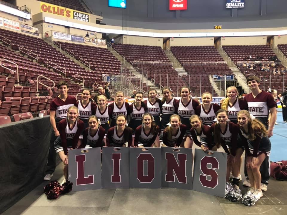 """State High's 2018-2019 cheerleaders pose for a team picture at PIAA states this year! The team qualified for semifinals for the first time in State High history. """"I was so proud of my team and to be able to represent our school and our community on the state level,"""" Emma Wenrick, junior, said."""