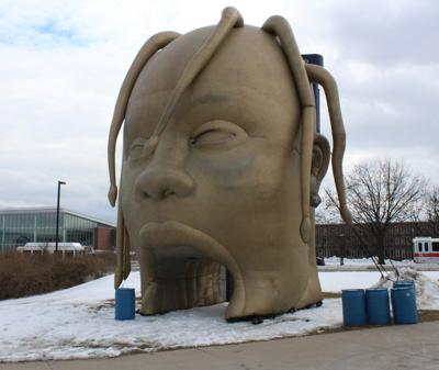 "Travis Scott visits the Bryce Jordan Center on February 26, 2019. ""Many people got pictures in front of the Travis head, and it just added more excitement to be here,"" said Carson Franks, Sophomore. Travis Scott didn't entertain the audience just from the thirty songs he performed, but also from the roller coaster and exciting props he brought with him."