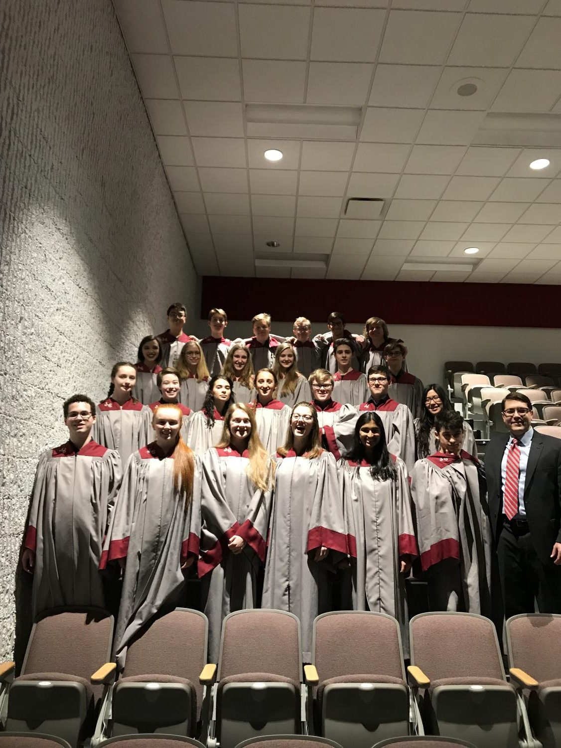 "State High singers who competed at the Pennsylvania Music Educators Association (PMEA) District chorus festival pose with their director, Erik Clayton. 25 of the 27 students representing State High advanced on to the Regional competition.  ""I was extremely proud of how well everyone did! I thought it was a very successful festival,"" said Clayton."