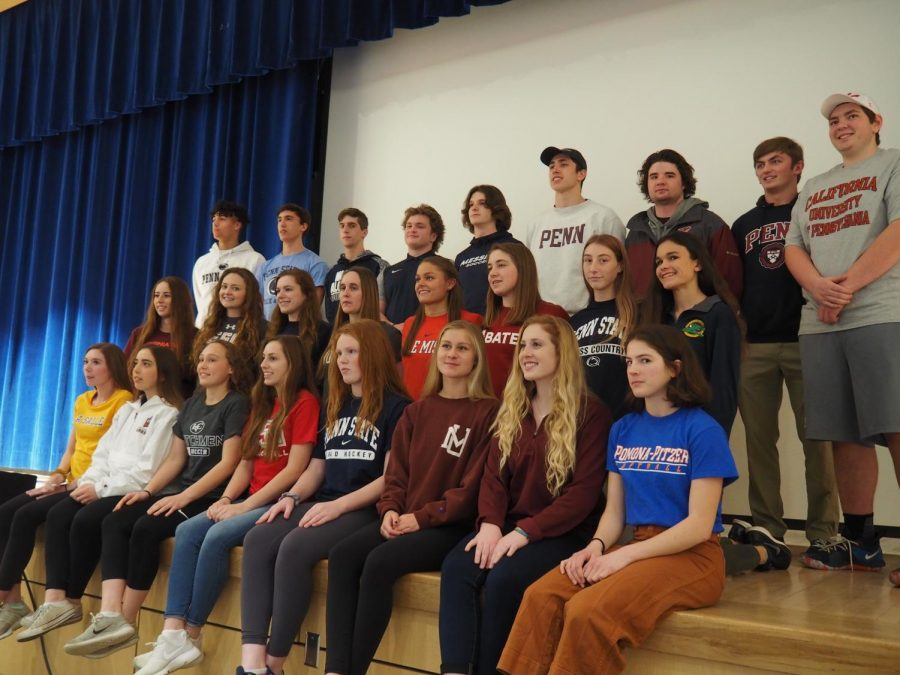 A+group+of+State+High+students+sign+to+continue+their+athletic+careers.+Kayla+Moran+said%2C+%22It+was+really+great+to+see+everyone+I+grew+up+with+being+acknowledged+on+their+big+accomplishments.%22+