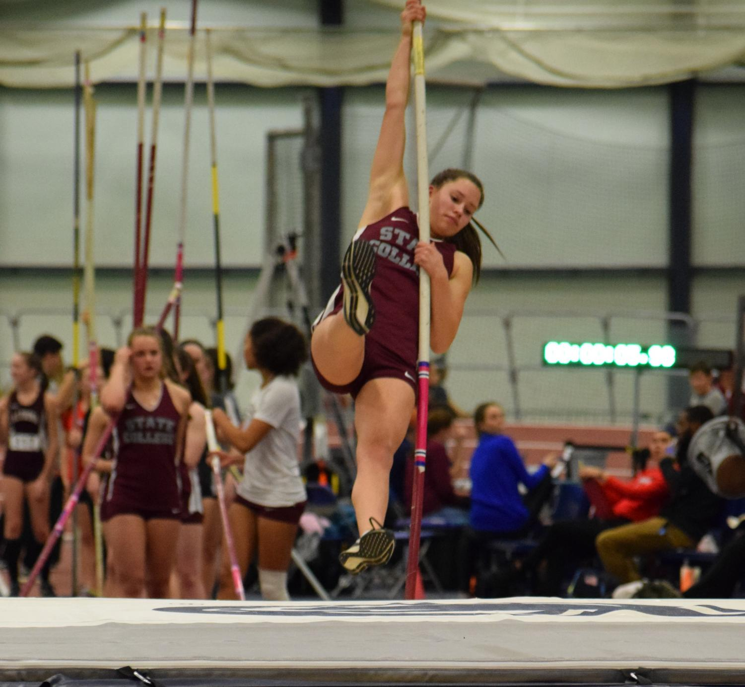 Mia Iceland warms up before an indoor track meet. The pole vaulter has been competing since the beginning of last year.