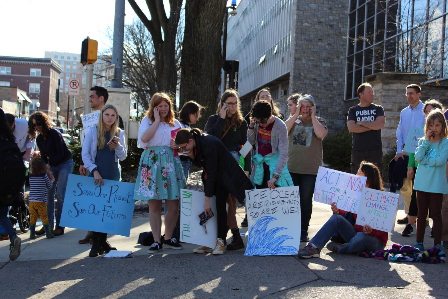 """State High ralliers call their local officials to advocate for climate change on March 15th, 2019. The rally was organized by State High Senior Abbie La Porta. """"The Youth Climate Strike is doing so many amazing things around the country right now. We just started so small and ended up reaching out and finding young people all over who resonated with our message and who are also scared for their futures"""" La Porta said."""