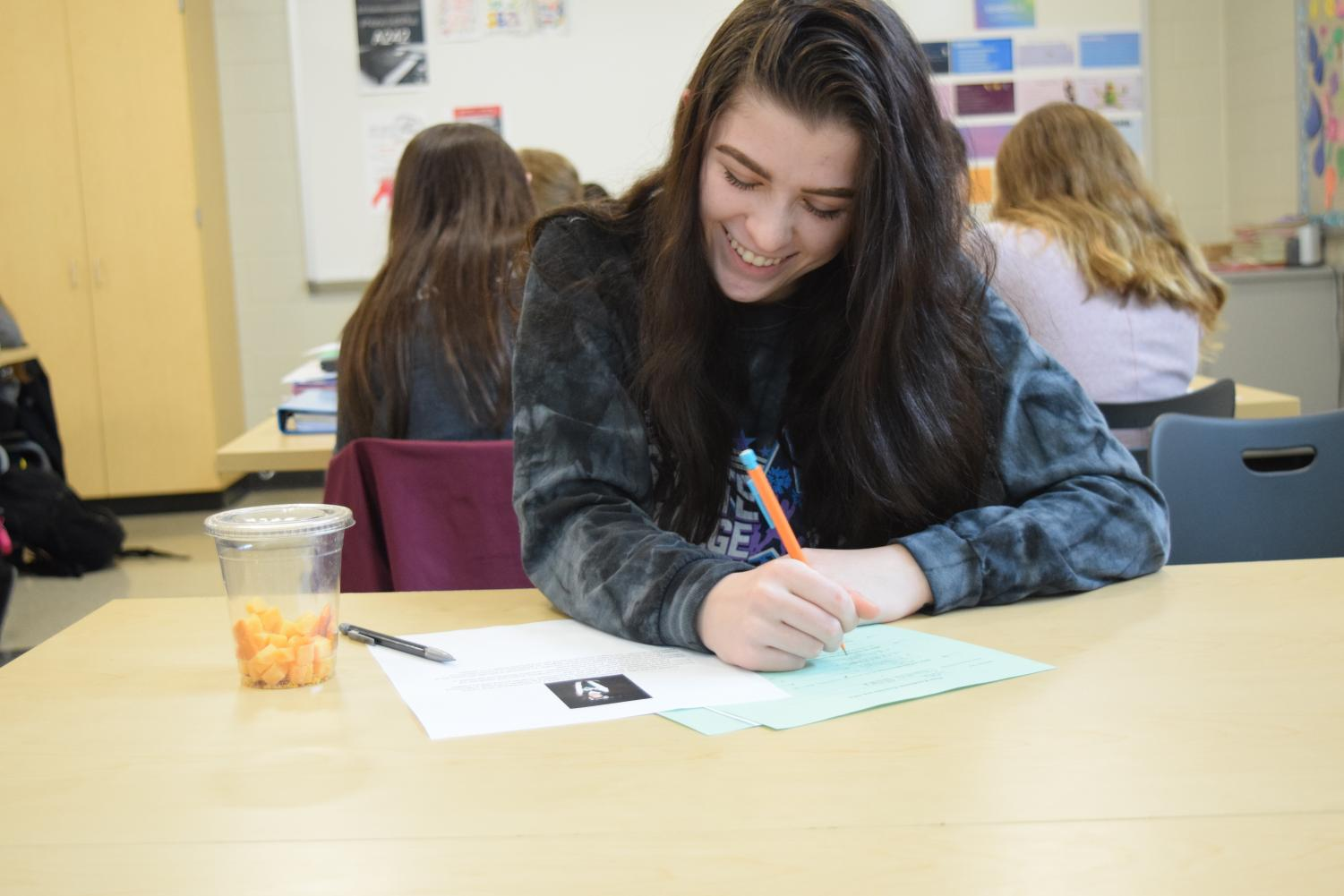 """Paige Miller, State High freshman, works on a peer review project for her Spanish class. Written projects and essays are often used in world languages to promote comfortability and familiarity with students' languages. """"In Spanish, we get to learn about another culture while having a great time with our teacher, Señor Gallo,"""