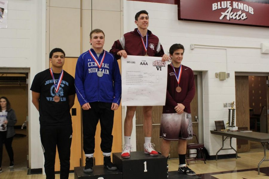 Senior+Cole+Urbas+on+the+podium+after+his+first+place+finish+in+his+weight+class+%28195+lbs%29.+He+traveled+to+Altoona+to+compete+in+Wrestling+Districts+on+February+23%2C+2019.+%E2%80%9CIt+feels+so+good+to+place+first+knowing+my+family+and+girlfriend+were+in+the+stands+cheering+me+on+as+well+as+my+team+believing+in+me%2C%E2%80%9D+Urbas+said.+