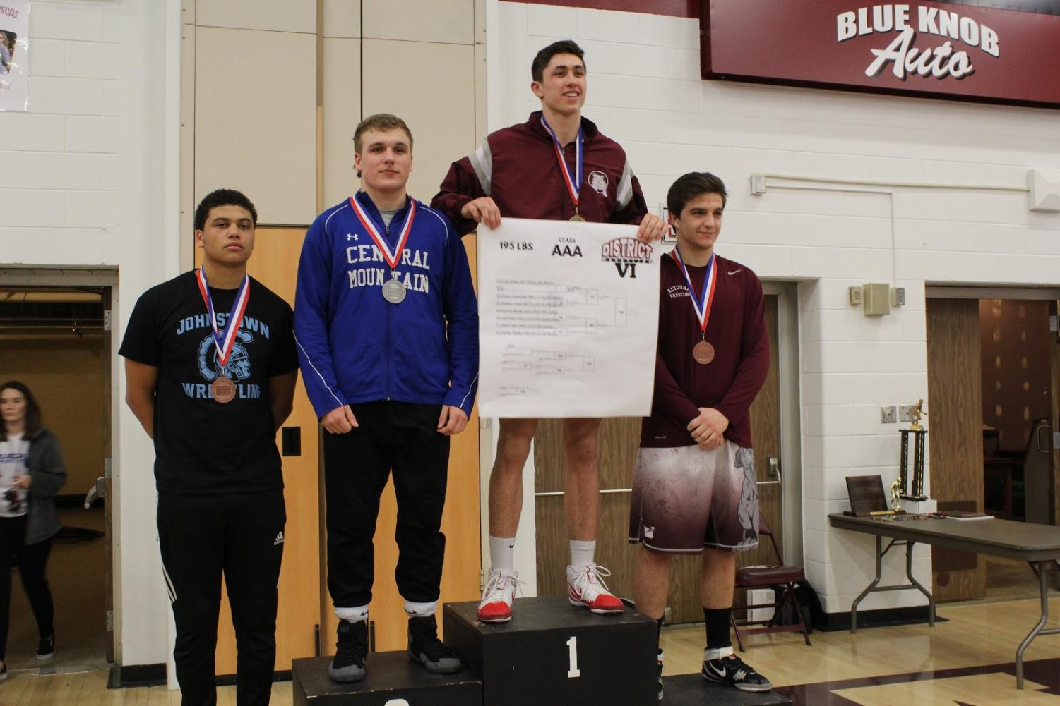 "Senior Cole Urbas on the podium after his first place finish in his weight class (195 lbs). He traveled to Altoona to compete in Wrestling Districts on February 23, 2019. ""It feels so good to place first knowing my family and girlfriend were in the stands cheering me on as well as my team believing in me,"" Urbas said."