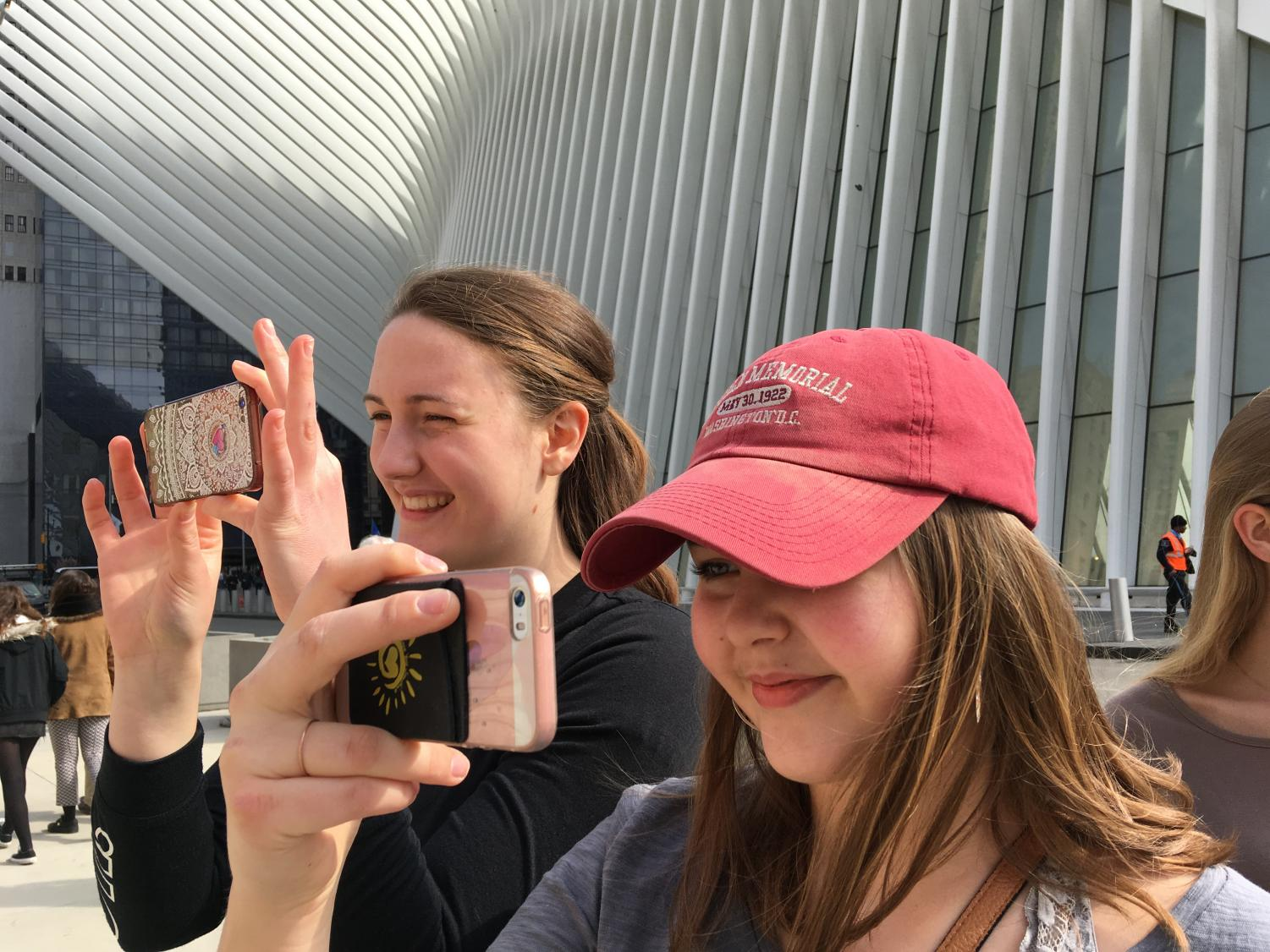 "While on the music adjudication trip in New York City, senior Anna Curtis and junior Mary Ellen Schomer take photos of the World Trade Center. The music ensembles from State High won the majority of their respective categories and garnered a total of 17 trophies. ""This was my first time in New York City and when I saw the city line when we first drove in it was really exhilarating,"" Schomer said."