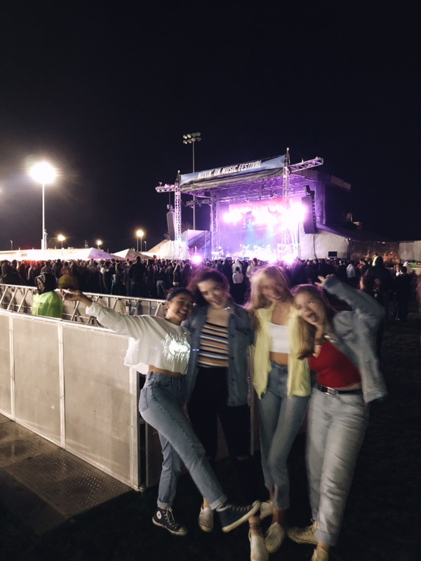 "Students flood the Penn State blue band IM field on April 26, 2019, for Movin' On. ""I'm sad I missed Bryce Vine play, but Grouplove was great and I had a lot of fun,"" Clarre Porter, sophomore on the left, said. Hundreds of people aged 18 and up enjoyed the student-run concert with Grouplove and A$AP Ferg."