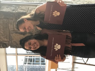 "Juniors Natalia Carrasco and Megan Stoltzfus pose with their NHS certificates at the Induction Ceremony in May 2019. ""I think some of the people here are going to have a really big impact on me,"" Carrasco said."